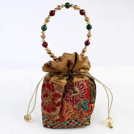 This beautiful potli bag is adorned with traditional work and is in in ...