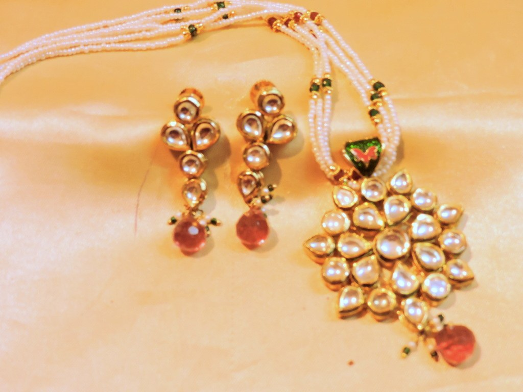 royal kundan pendent set with pearl chain available at Craftsvilla for Rs.3599