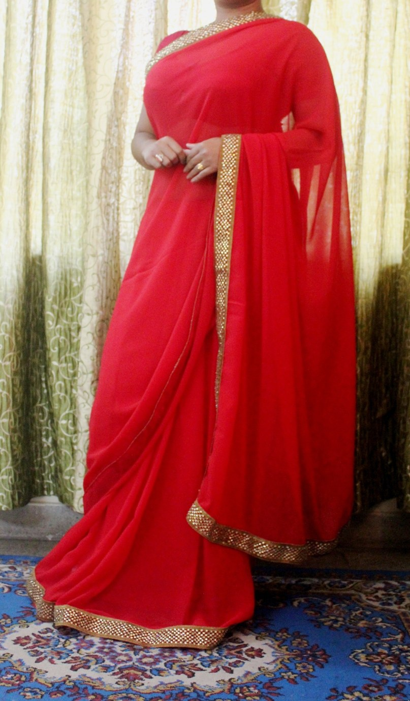 Georgette red saree with attractive golden border studded ...